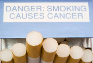 close-up-of-cigarettes-in-packet-with-cancer-warning
