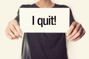 person-holding-a-sign-that-has-the-word-written-on-it-i-quit-smoking