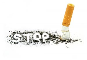 stop-smoking-written-in-ash-with-stubbed-cigarette